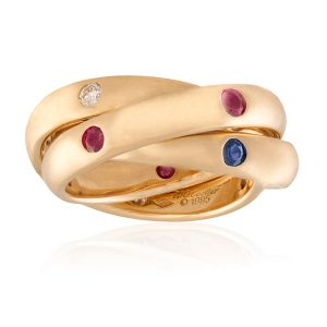 Lot 11: A RUBY, SAPPHIRE AND DIAMOND 'TRINITY' RING, BY CARTIER, 1995 Estimate €1,500 - €2,000